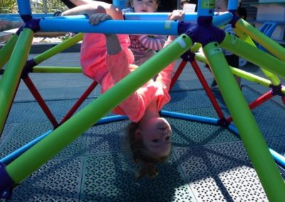 Child playing on climbing frame at Little Splashes Childcare Centre at Baywave