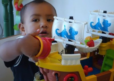 Child playing with pirate ship at Little Splashes Childcare Centre at Baywave