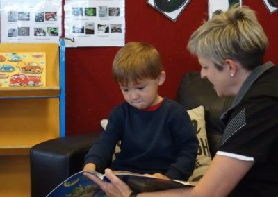 Child reading a book at Little Splashes Childcare Centre at Baywave